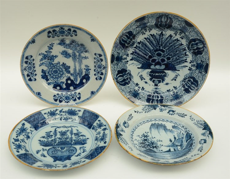 A late 17thC blue and white decorated Dutch Delftware plate; added three di