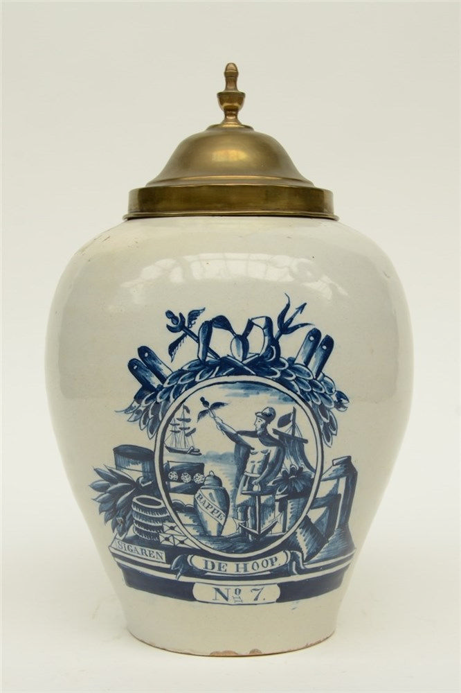 An 18thC blue and white Delft tabacco jar, marked 'De Drie Klokken', and br