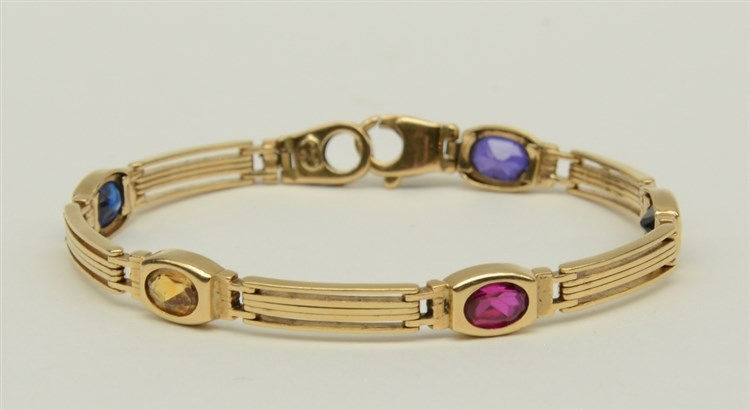 An 18ct gold bracelet, set with various gems, L 19 cm, Total weight: ca. 20