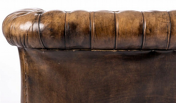 A chesterfield two seater sofa with leather upholstery h 75 for Sofa 75 cm tief