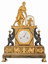 A Neoclassical gilt and patinated bronze mantel clock, the clock itself flanked by two sphinxes, the dial marked 'Rocquet à Paris', H 54 - W 40,5 - D 15,5 cm