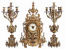 A bronze / brass renaissance revival garniture (center clock and two candelabra), H 67 - 68,5 cm