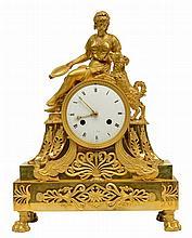 A second quarter of the 19thC ormolu bronze mantel clock said 'à sujèt', depicting an allegory of fidelity, H 43 cm