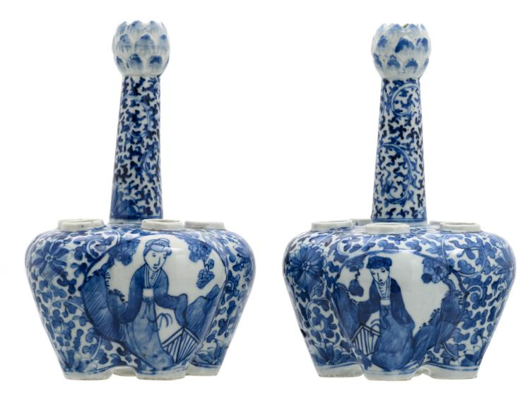 A pair of Chinese blue and white floral and relief decorated tulip vases, the roundels with figures in a landscape; Qianlong marked, 19thC, H 26 - ø 17 cm