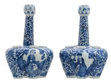 A pair of Chinese blue and white floral and relief decorated tulip vases, the roundels with figures in a landscape; Qianlong marked, 19thC,H 26 - ø 17 cm