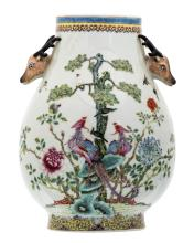 A Chinese famille rose decorated Hu vase with birds and flower branches, the handles deer head shaped, with a Qianlong mark, H 34,5 cm