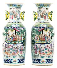 A pair of Chinese famille rose overall decorated vases with an animated court scene, 19thC, H 61 cm