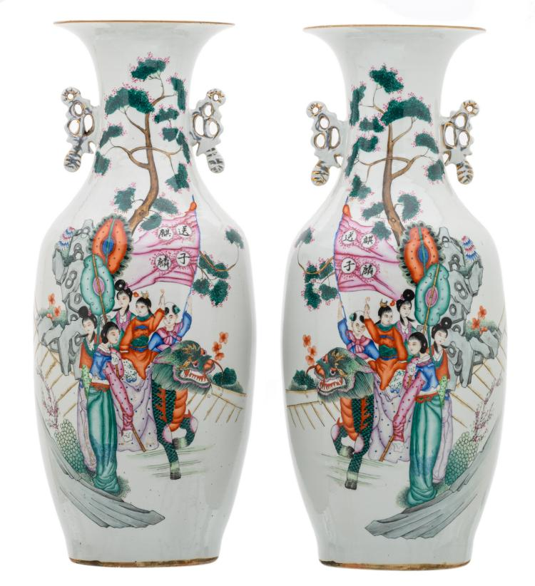 A pair of Chinese famille rose decorated vases with figures in a cortege and calligraphic texts, H 58 cm
