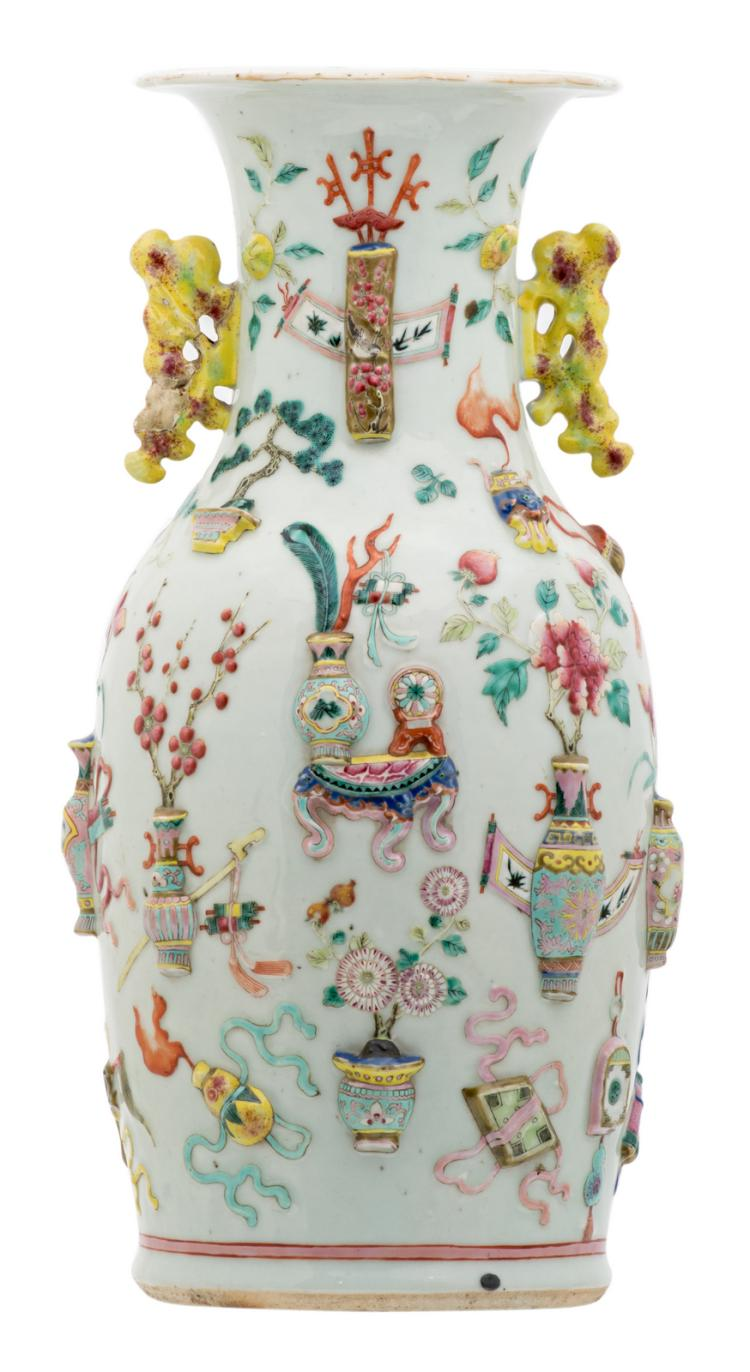 A Chinese famille rose and relief decorated vase with antiquities, flower branches and birds, 19thC, H 45,5 cm