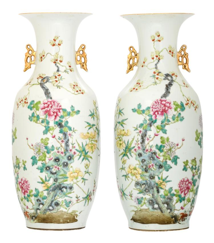 A pair of Chinese famille rose decorated vases with flower branches on a rock and bats, marked, H 58 cm