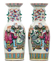 A pair of Chinese famille rose and polychrome decorated vases with figures and bats, 19thC, H 59,5 cm