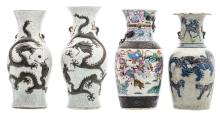 Four Chinese relief decorated crackleware stoneware vases, one vase famille rose, one vase blue and white and copper red decorated, marked, about 1900, H 43,5 - 46 cm