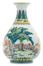 A Chinese doucai overall decorated pear shaped vase with various plants amid rockwork in the garden, Qianlong marked, H 29,5 cm