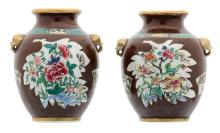 Two Chinese café au lait ground vases, the roundels famille rose, decorated with rocks, flower branches and a butterfly, the side panels encre de chine and gilt decorated with a landscape, 18thC, H 20 cm