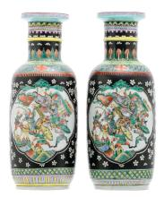 Two Chinese polychrome decorated rouleau shaped vases, the roundels famille verte with a court and a battle scene, with a Kangxi mark,H 48 cm