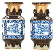 A pair of Chinese blue and white and relief decorated stoneware vases, the roundels with flower branches and landscapes, marked, 19thC, H 35,5 cm