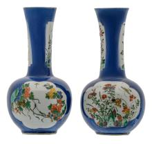 Two Chinese bleu poudré ground bottle vases, the roundels famille verte, decorated with rocks, flower branches and insects, 19thC, H 26,5 cm