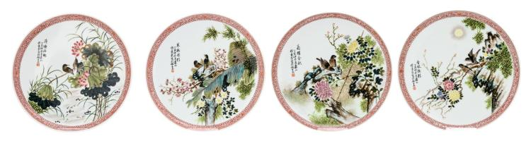 A set of four Chinese famille rose dishes, decorated with birds, flower branches and a calligraphic text, marked, H 3,5 - ø 24 cm