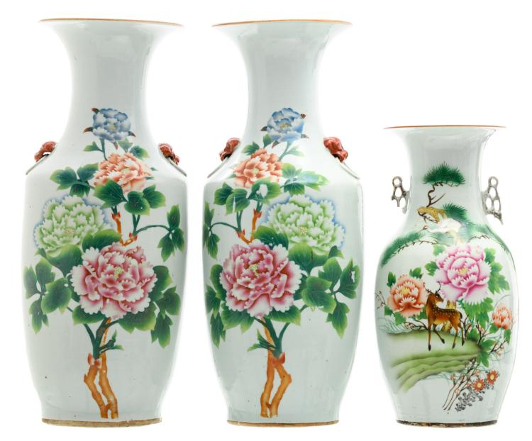 A pair of Chinese polychrome decorated vases with flower branches and calligraphic texts; added a ditto vase with a deer and a crane,H 42,5 - 57,5 cm