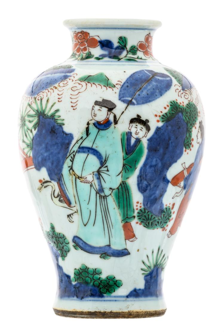A Chinese overall polychrome decorated vase with figures in a rock garden, H 19 cm