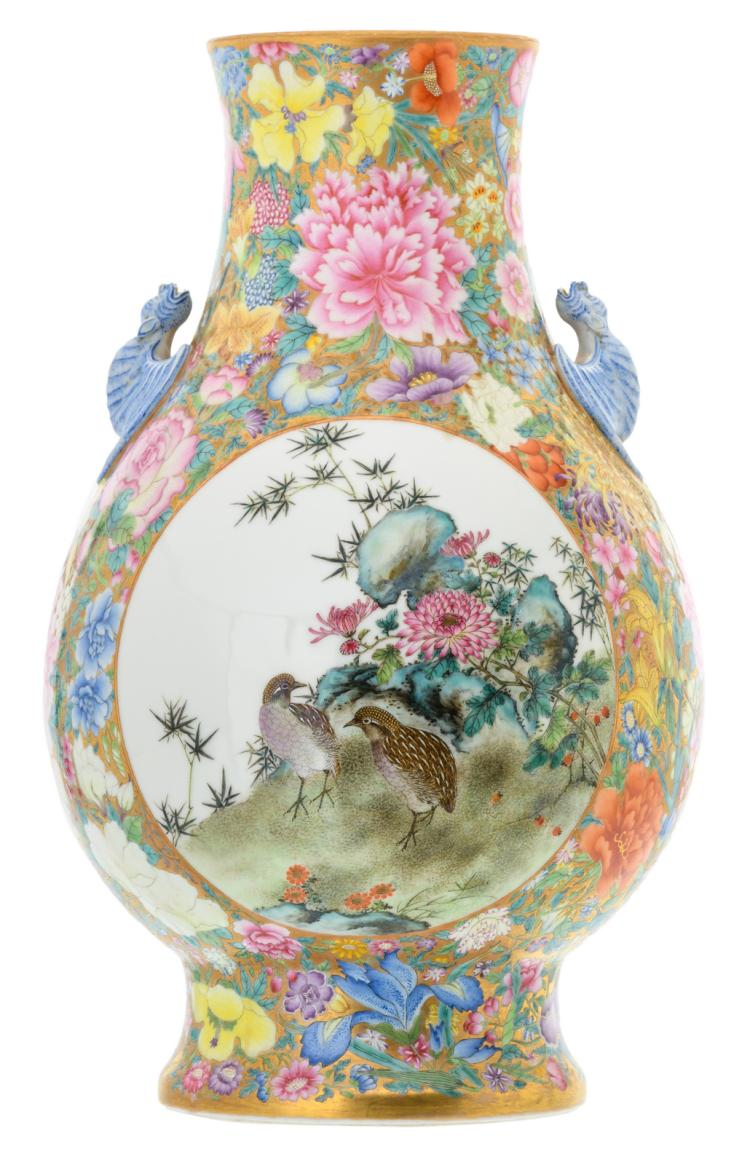 A fine Chinese millefleurs and famille rose vase, the roundels decorated with birds, rocks and flower branches, the handles bat shaped, marked, H 41,5 cm