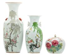 Two Chinese famille rose vases and a ditto ginger jar and cover, decorated with flower branches and birds, one vase marked,H 22,5 - 57,5 cm