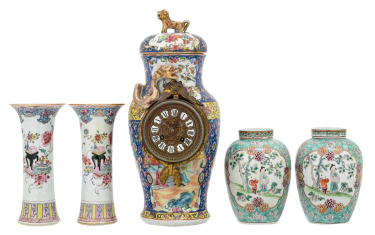 A pair of Chinese turquoise ground famille rose floral decorated ginger jars and covers, the roundels with figures in a landscape; added two ditto vases and a vase and cover, mounted to a clock, 19thC, H 19 - 41,5 cm