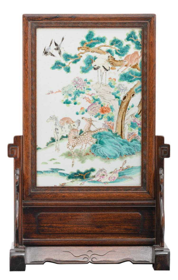 A fine Chinese hardwood table screen, the famille rose plaque decorated with horses, deers, monkeys and birds in a landscape,H 71,5 - W 44,5 - D 21,5 cm