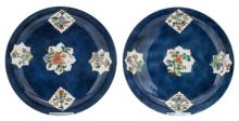 Two Chinese bleu poudré dishes, the roundels famille verte, decorated with antiquities and flower branches, with a symbol mark, 18thC, H 5 - D 27 cm