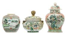 A Chinese famille verte floral decorated vase and cover and ginger jar, the roundels with landscapes and auspicious symbols, 19thC, added a ditto pot and cover with gilt brass mounts, the roundels decorated with court scenes, H 21 - 34 cm