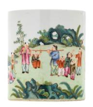 A Chinese famille rose brushpot, overall decorated with boys playing in a garden, with a Qianlong mark, H 15 cm