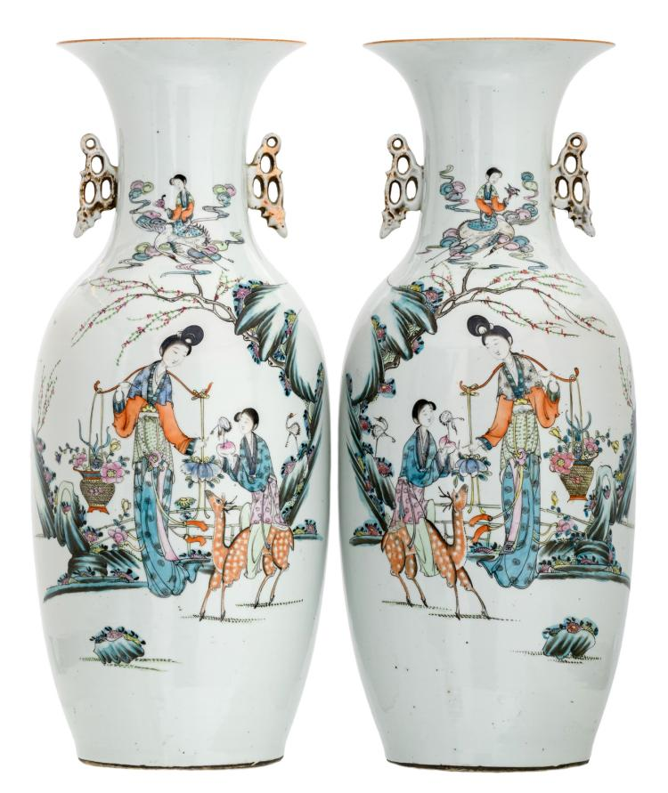 A pair of Chinese polychrome decorated vases with ladies, cranes and a deer in a garden and calligraphic texts, H 58 cm