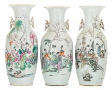 Two Chinese famille rose vases, decorated with a gallant garden scene and calligraphic texts; added a ditto vase, decorated with a lady and playing children, H57,5 - 59 cm