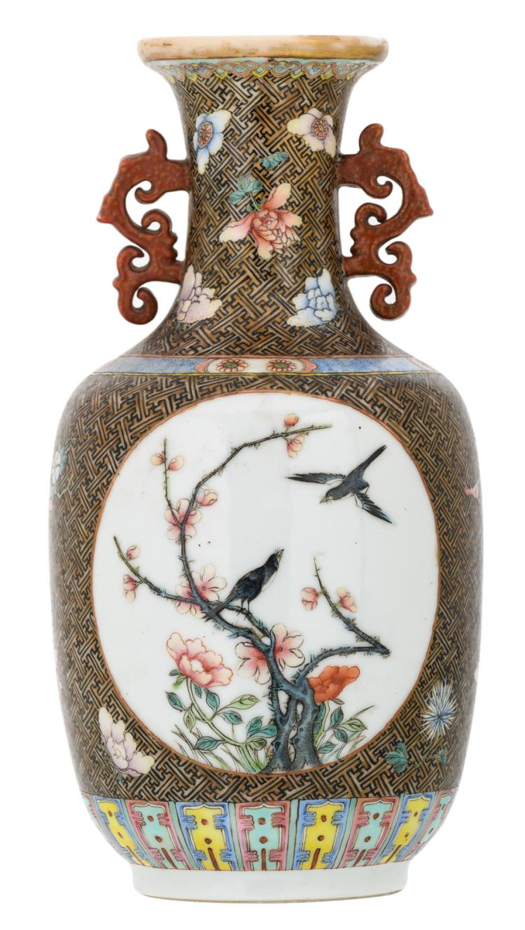 A Chinese famille rose floral decorated vase, the roundels with birds and flower branches, with a Qianlong mark, H 22,5 cm