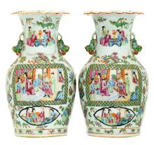 A pair of Chinese Canton famille rose floral decorated vases, the roundels with various court and garden scenes, 19thC, H 33,5 cm