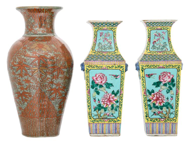 A pair of Chinese turquoise ground famille rose quandrangular vases, the roundels decorated with flower branches and buttterflies, 19thC; added an Oriental crackleware iron red and gilt decorated stoneware vase with floral motifs, H 43,5 - 49 cm