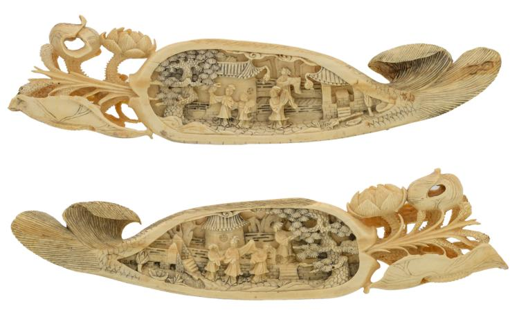 A pair of Chinese ivory lotus and fish shaped wristrests, relief decorated with an animated scene, first of the half 20thC,H 2,5 - 6,5 - B 6,5 - D 3,5 - L 28 - 29,5 cm - Weight: 527g