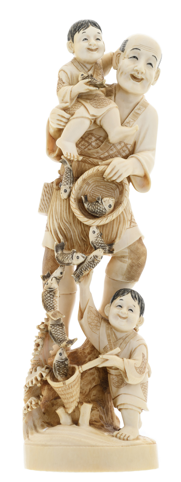 A Japanese ivory okimono depicting a fishmonger and his children from daily life in the Meiji period, partially tinted, marked, H 34 cm - Weight: 1640g