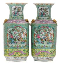 Two Chinese turqoise ground famille rose baluster shaped vases, decorated with dragons, birds and flower branches, 19thC, H 45 cm