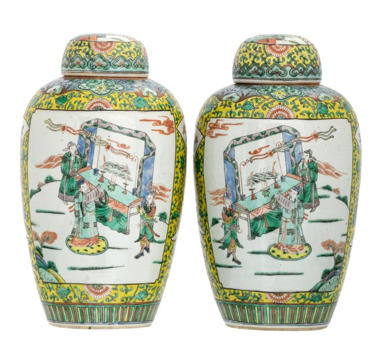 A pair of Chinese yellow ground famille verte floral decorated pots and covers, the roundels with animated scenes, H 40 cm