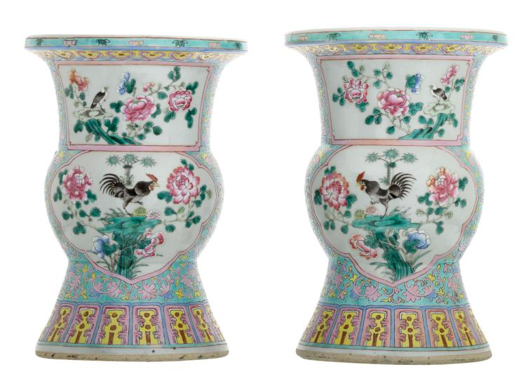A pair of Chinese famille rose floral decorated beaker vases, the roundels with birds and flower branches, H 36 - 36,5 cm