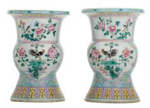 A pair of Chinese famille rose floral decorated beaker vases, the roundels with birds and flower branches,H 36 - 36,5 cm