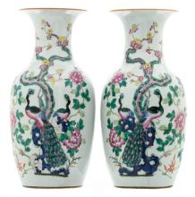 A pair of Chinese famille rose vases, decorated with peacocks, flower branches and antiquities, 19thC, H 44 cm