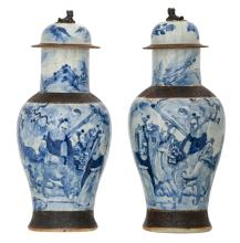 Two Chinese stoneware blue and white decorated crackleware vases and covers with deities in a landscape, marked, about 1900,H 49,5 - 50 cm