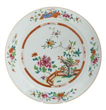 A Chinese famille rose floral decorated plate with flower branches and auspicious symbols, early 18thC,ø 41 cm