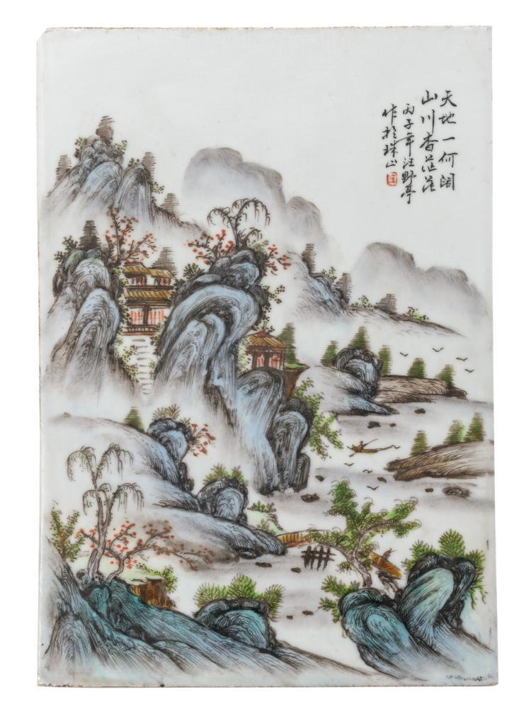 A Chinese polychrome porcelain plaque, decorated with a mountainous river landscape and a calligraphic text, 25,5 x 36,5 cm