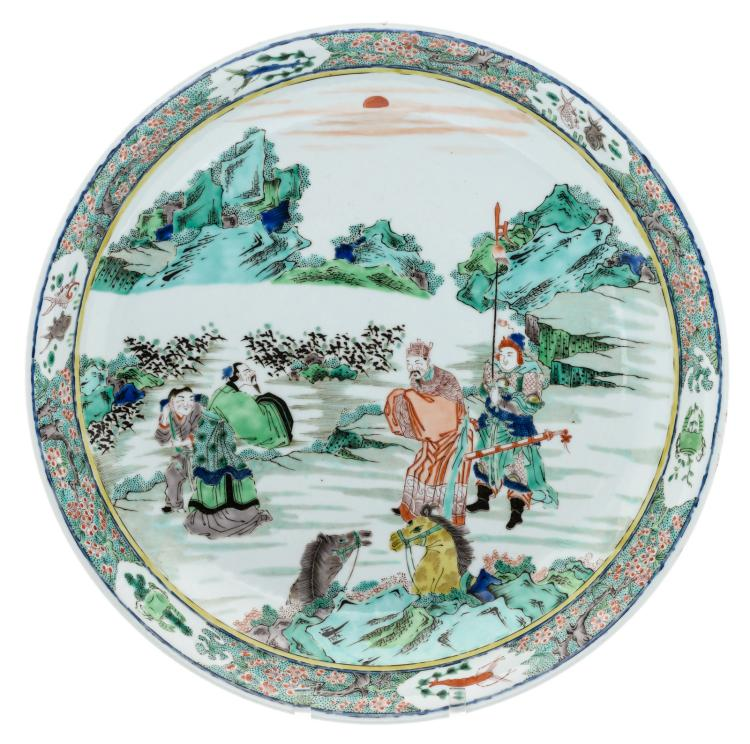 A Chinese famille verte plate, decorated with figures and horses in a mountainous landscape,H 8 - ø 43 cm