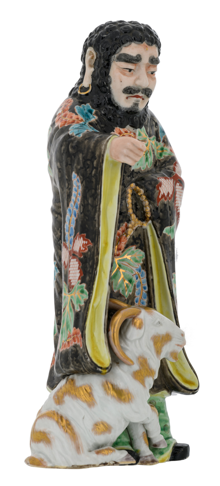 A Chinese polychrome decorated figure depicting a deity and a goat, H 30,5 cm