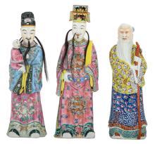 Three Chinese famille rose Fu - Lu - Shou Xing figures, one marked with an impressed seal mark, 19thC, H 45,5 - 52 cm