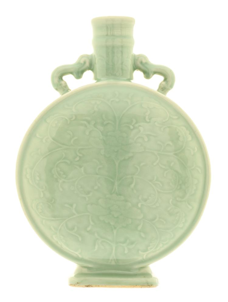 A Chinese celadon moonflask with carved floral motifs, Song type, H 34,5 - W 24,5 cm